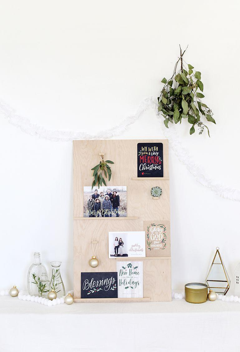 """<p>Create shelves on a wooden board and use them to hold cards. Make the board feel a little more festive by hanging ornaments or mistletoe. </p><p>Get the tutorial at <a href=""""https://themerrythought.com/diy/diy-christmas-card-display/"""" rel=""""nofollow noopener"""" target=""""_blank"""" data-ylk=""""slk:The Merry Thought"""" class=""""link rapid-noclick-resp"""">The Merry Thought</a>.</p>"""