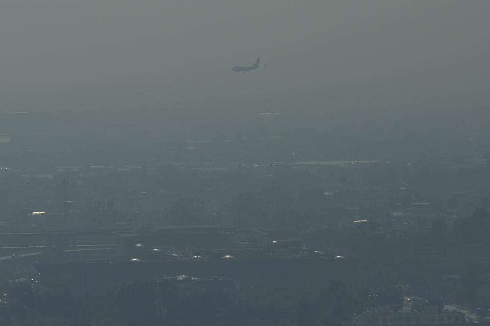 MEXICO CITY, MEXICO - APRIL 5: Heavy mist blankets Mexico City on April 5, 2016. in Mexico City, Mexico. Authorities have declared a pollution alert after smog rose to one and a half times acceptable limits.  In response, the city's government is taking one million old and new cars alike off the road each day of the week for the next three months in an effort to reduce the alarming pollution levels. (Photo by Miguel Tovar/LatinContent via Getty Images)