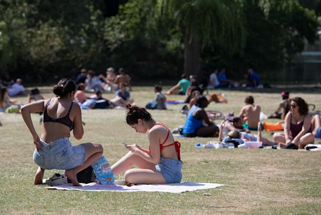 Sunbathers by the lake on a sunny Bank Holiday Monday in Regents Park on 25 May, in London, England. (Jo Hale/Getty Images)