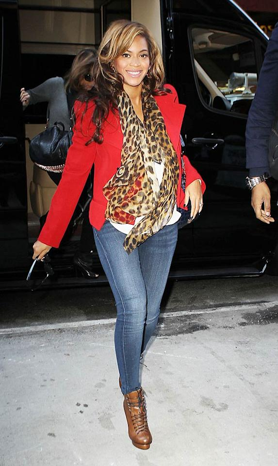 Back in NYC, Beyonce proved you can still be stylish while pregnant when she was snapped exiting an office building wearing jeans, a bright red blazer, a leopard-print scarf, and a smile. (11/1/2011)