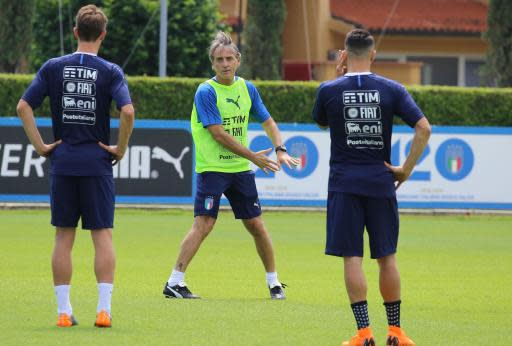 Roberto Mancini, center, coach of the Italian national soccer team, leads a training session at the Coverciano Sports Center, near Florence, Italy, Thursday, May 24, 2018. (Claudio Giovannini/ANSA via AP)
