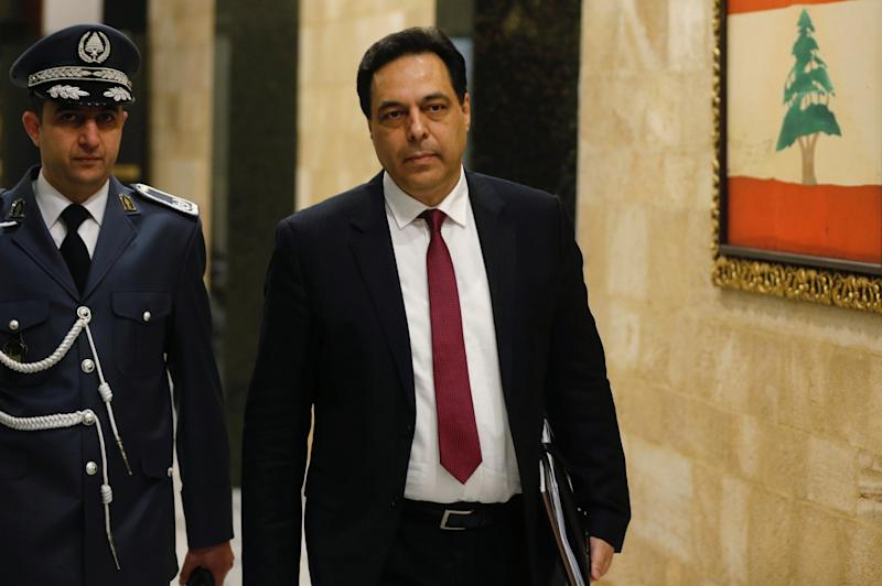 Lebanon's Prime Minister Hassan Diab arrives at the presidential palace in Baabda