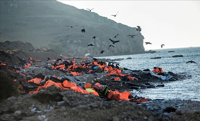 Life vests left by migrants and refugees after arriving on the shores of the Greek island of Lesbos after crossing the Aegean Sea from Turkey are seen on November 12, 2015