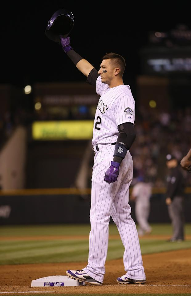 DENVER, CO - MAY 03: Troy Tulowitzki #2 of the Colorado Rockies acknowledges the fans after hitting his 1000th career hit, a single off of relief pitcher Daisuke Matsuzaka #16 of the New York Mets in the seventh inning at Coors Field on May 3, 2014 in Denver, Colorado. (Photo by Doug Pensinger/Getty Images)