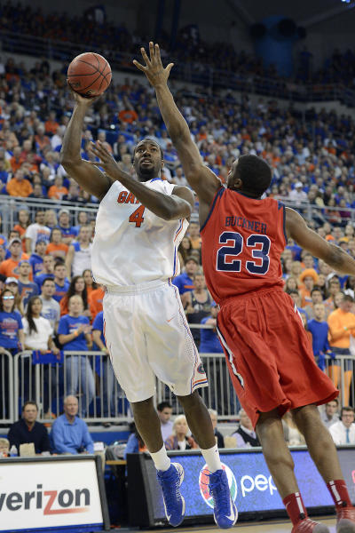 FILE - In this Saturday, Feb. 2, 2013 file photo, Florida Gators center Patric Young (4) shoots to score as Mississippi forward Reginald Buckner (23) defends during the first half of an NCAA college basketball game in Gainesville, Fla. There are a wide range of title contenders in this college basketball season, including Florida. (AP Photo/Phil Sandlin, File)