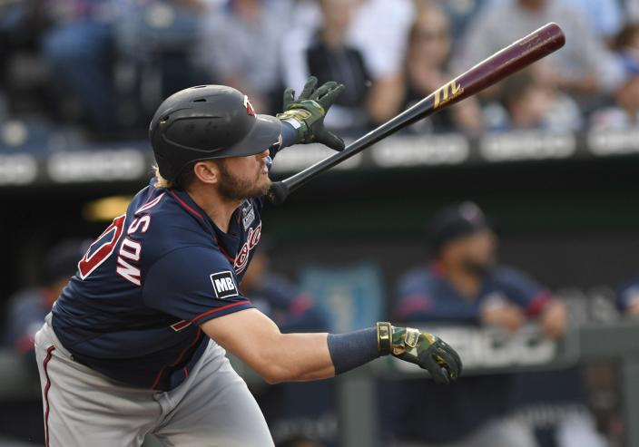 Minnesota Twins' Josh Donaldson tosses his bat after hitting a solo home run during the first inning of the team's baseball game against the Kansas City Royals, Thursday, June 3, 2021, in Kansas City, Mo. (AP Photo/Reed Hoffmann)