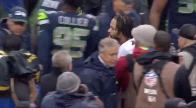 Watch: Seattle Seahawks' Pete Carroll and Baltimore Ravens' Earl Thomas ignore each other after the Seahawks' loss