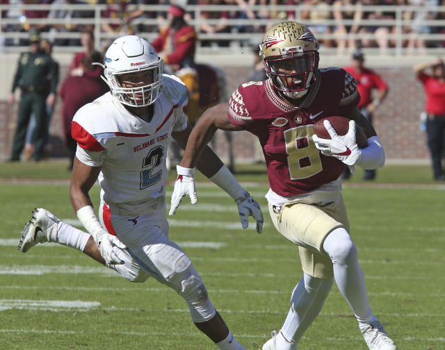 Florida State's Nyqwan Murray picks up yards after a catch as Delaware State's Jahed Neibauer pursues in the second quarter of an NCAA college football game, Saturday, Nov. 18, 2017, in Tallahassee Fla. Florida State won 77-6. (AP Photo/Steve Cannon)