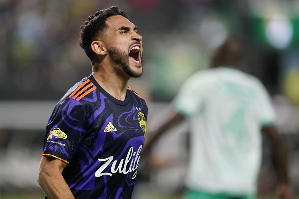 Seattle Sounders' Cristian Roldan (7) celebrates after scoring against Club Leon during the second half of the Leagues Cup soccer final Wednesday, Sept. 22, 2021, in Las Vegas. (AP Photo/John Locher)