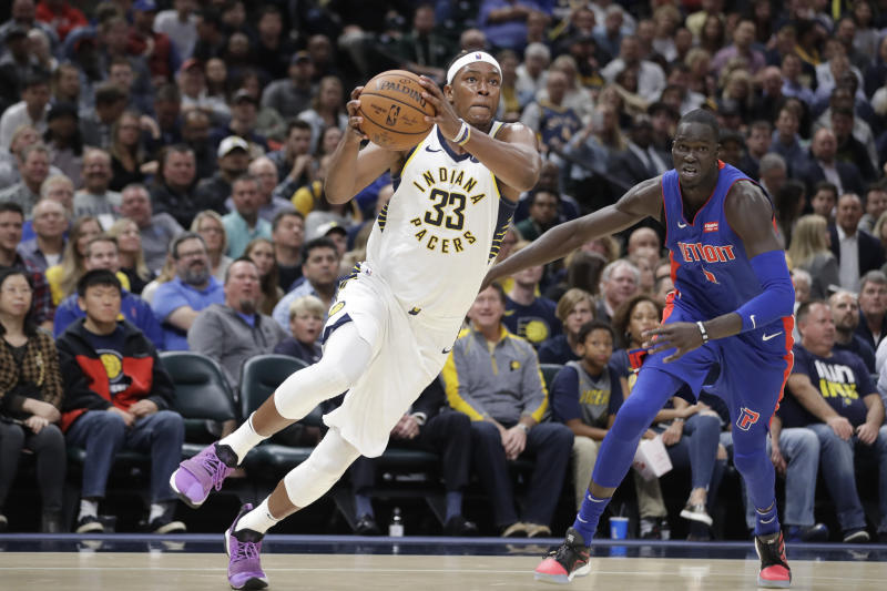 Indiana Pacers' Myles Turner (33) goes to the basket against Detroit Pistons' Thon Maker (7) during the second half of an NBA basketball game, Wednesday, Oct. 23, 2019, in Indianapolis. Detroit won 119-110. (AP Photo/Darron Cummings)