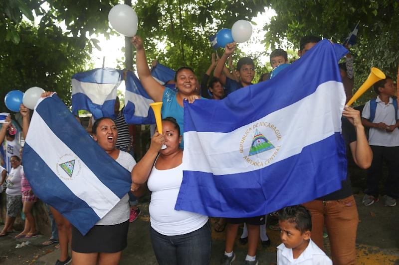 Friends and neighbours celebrate after student leader Edwin Carcache (not pictured) was released from prison, in Managua on June 11, 2019 (AFP Photo/Maynor VALENZUELA)