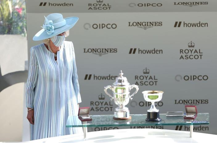 <p>Camilla, Duchess of Cornwall, just prior to presenting Manning with a trophy. </p>