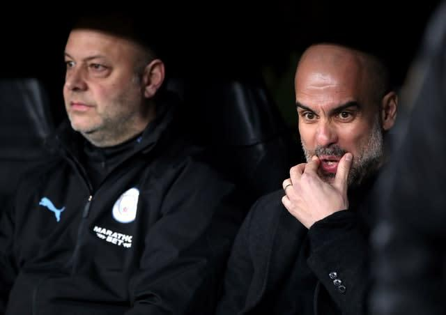Pep Guardiola, right, shocked many with his team selection (Nick Potts/PA)