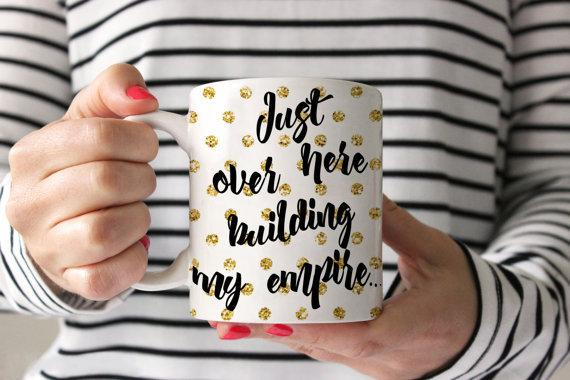 "<p>Motivational Mug, £15, <a href=""https://www.etsy.com/uk/listing/268686178/coffee-mug-building-my-empire-coffee-mug?ga_order=most_relevant&ga_search_type=all&ga_view_type=gallery&ga_search_query=girl%20power&ref=sc_gallery_3&plkey=c9bad699994f0700842682a26892acf9b0bde323:268686178"">Etsy</a></p>"