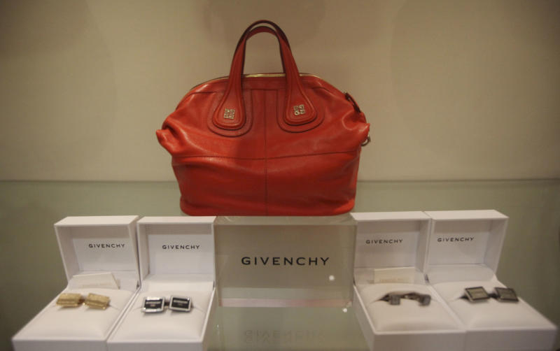 A handbag and other goods by designer Givenchy are displayed for sale at a shop in Lagos, Nigeria, Wednesday, March. 21, 2012. The wealthy elite in Nigeria _ upstart business owners, oil industry executives and corrupt politicians _ have a healthy appetite for top shelf brands, but have had to shop in Dubai, London and Paris to find such brands. Now though, sellers of luxury goods are opening stores in Nigeria where seemingly gratuitous displays of wealth are the norm. (AP Photos/Sunday Alamba)