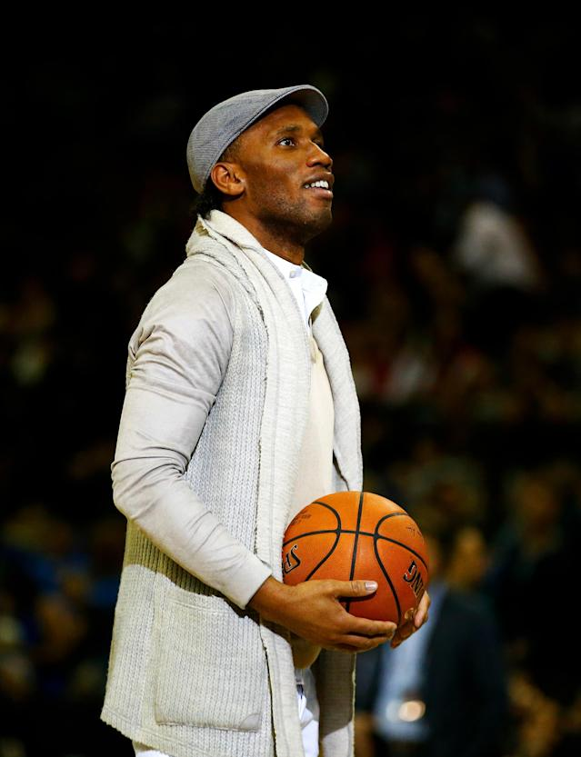 LONDON, ENGLAND - JANUARY 14: Former Chelsea footballer Didier Drogba in action on court during a break in the 2016 NBA Global Games London match between Toronto Raptors and Orlando Magic at The O2 Arena on January 14, 2016 in London, England. (Photo by Clive Rose/Getty Images)