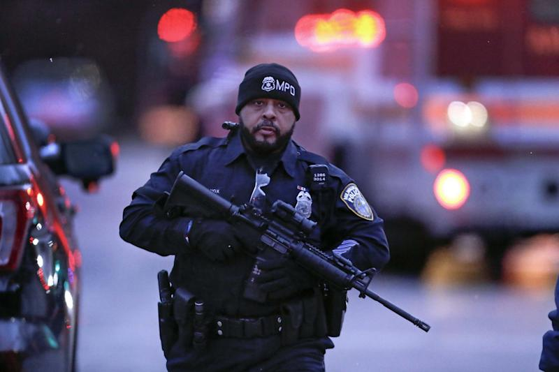 A Milwaukee police officer works the scene (Getty Images)