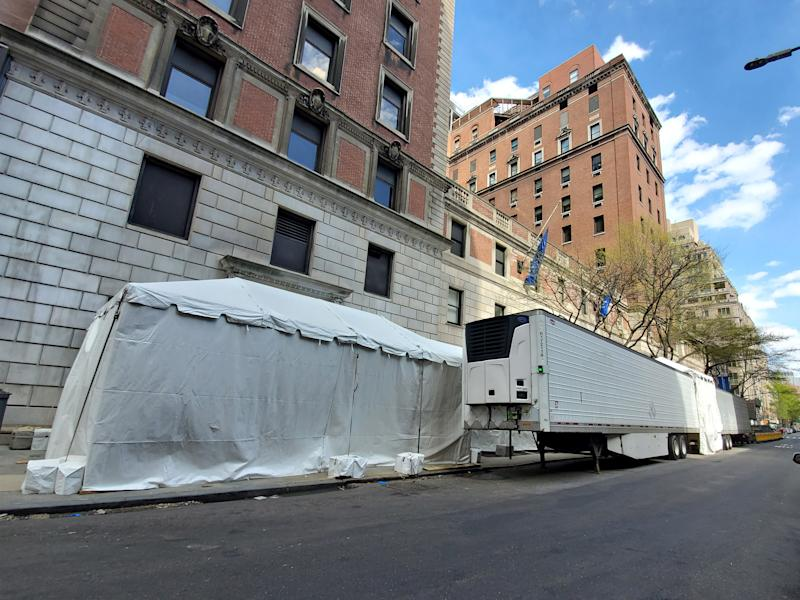 Pictured is a makeshift morgue on a road outside Lenox Hill Hospital.