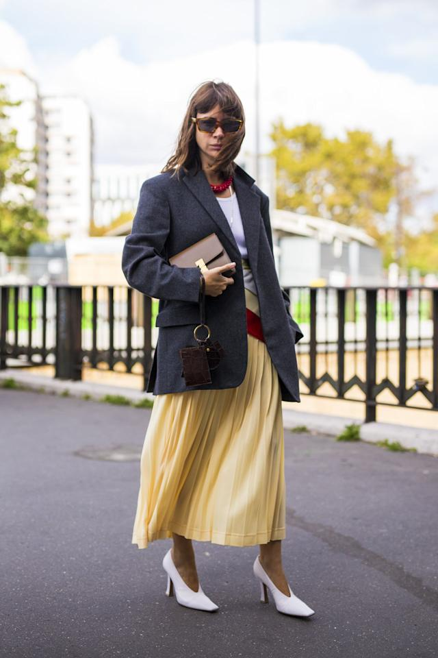 <p>Midi skirts have become a mainstay in our wardrobes, and Fall is ushering in a superfresh assortment, <em>plus</em> ankle-grazing lengths for a more dramatic look. Whether you're about fun colors, sleek slip skirts, or pretty prints, these elongated hemlines pair well with everything from boots to pumps at the office.</p>