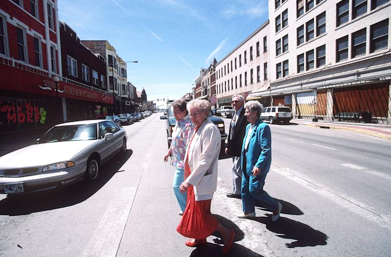 CHEYENNE, WY - MAY 2: (US NEWS AND WORLD REPORT AND NEWSWEEK OUT) Four elderly residents of Cheyenne, Wyoming, cross a downtown intersection, May 2, 2004. Cheyenne is the capital of Wyoming with a population of 53,000. Wyoming was incorporated into the U.S.in 1890 and is the 9th largest U.S. state. A recent survey showed a hypothetical family in Cheyenne earning $90,000, pays the lowest amount in local, state and federal taxes in the U.S. compared to Bridgeport, Connecticut, where the highest taxes would be paid. Wyoming has a population of 500,000. It is a key energy producing state with vast coal and natural gas deposits. (Photo by Robert Nickelsberg/Getty Images)