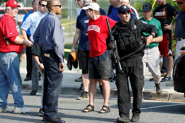 <p>Police investigate a shooting scene after a gunman opened fire on Republican members of Congress during a baseball practice near Washington in Alexandria, Virginia, June 14, 2017. (Photo: Joshua Roberts/Reuters) </p>