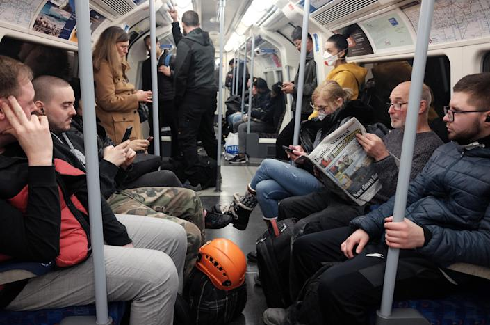 A busy Jubilee line Underground train, the day after Prime Minister Boris Johnson put the UK in lockdown to help curb the spread of the coronavirus. (Yui Mok/PA Wire)