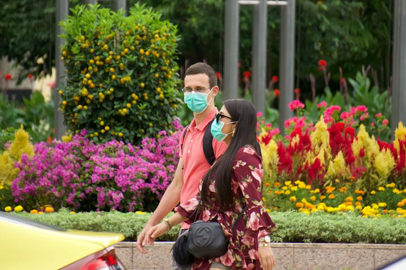People seen wearing face masks along Orchard Road on 9 February 2020. (PHOTO: Dhany Osman / Yahoo News Singapore)