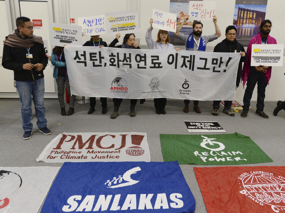 Young people protest in the main hall at the COP24 summit in Katowice, Poland, Thursday, Dec. 13, 2018.(AP Photo/Czarek Sokolowski)