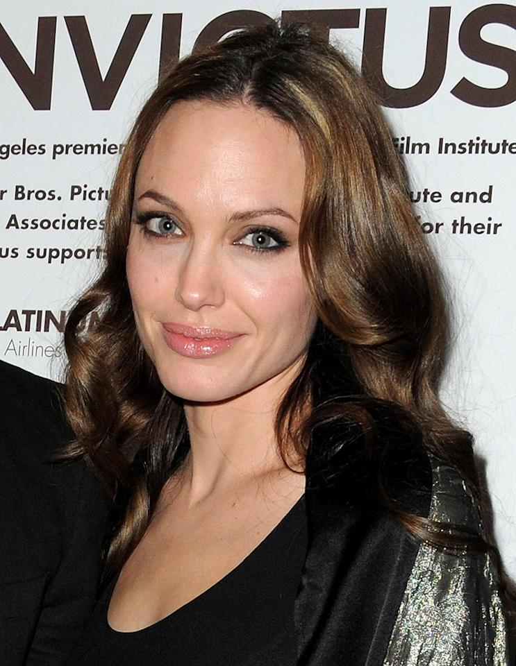 "Jen's tabloid rival, Angelina Jolie, prefers to show off her creamy skin in gorgeous gowns at movie premieres and at the many charitable events she attends. The ""Salt"" stunner turns 35 on June 4. Jordan Strauss/<a href=""http://www.wireimage.com"" target=""new"">WireImage.com</a> - December 3, 2009"
