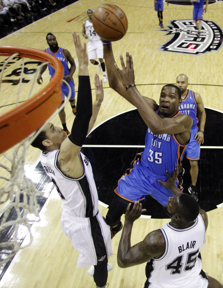 Oklahoma City Thunder small forward Kevin Durant (35) shoots over San Antonio Spurs guard Danny Green (4) and forward DeJuan Blair (45) during the first half of Game 5 in the NBA basketball Western Conference finals, Monday, June 4, 2012, in San Antonio. (AP Photo/Eric Gay, Pool)