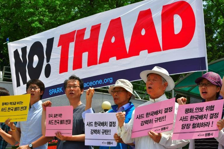 Anti-war activists protest against the planned deployment of the Terminal High Altitude Area Defense (THAAD) system outside South Korea's defence ministry in Seoul on July 8, 2016