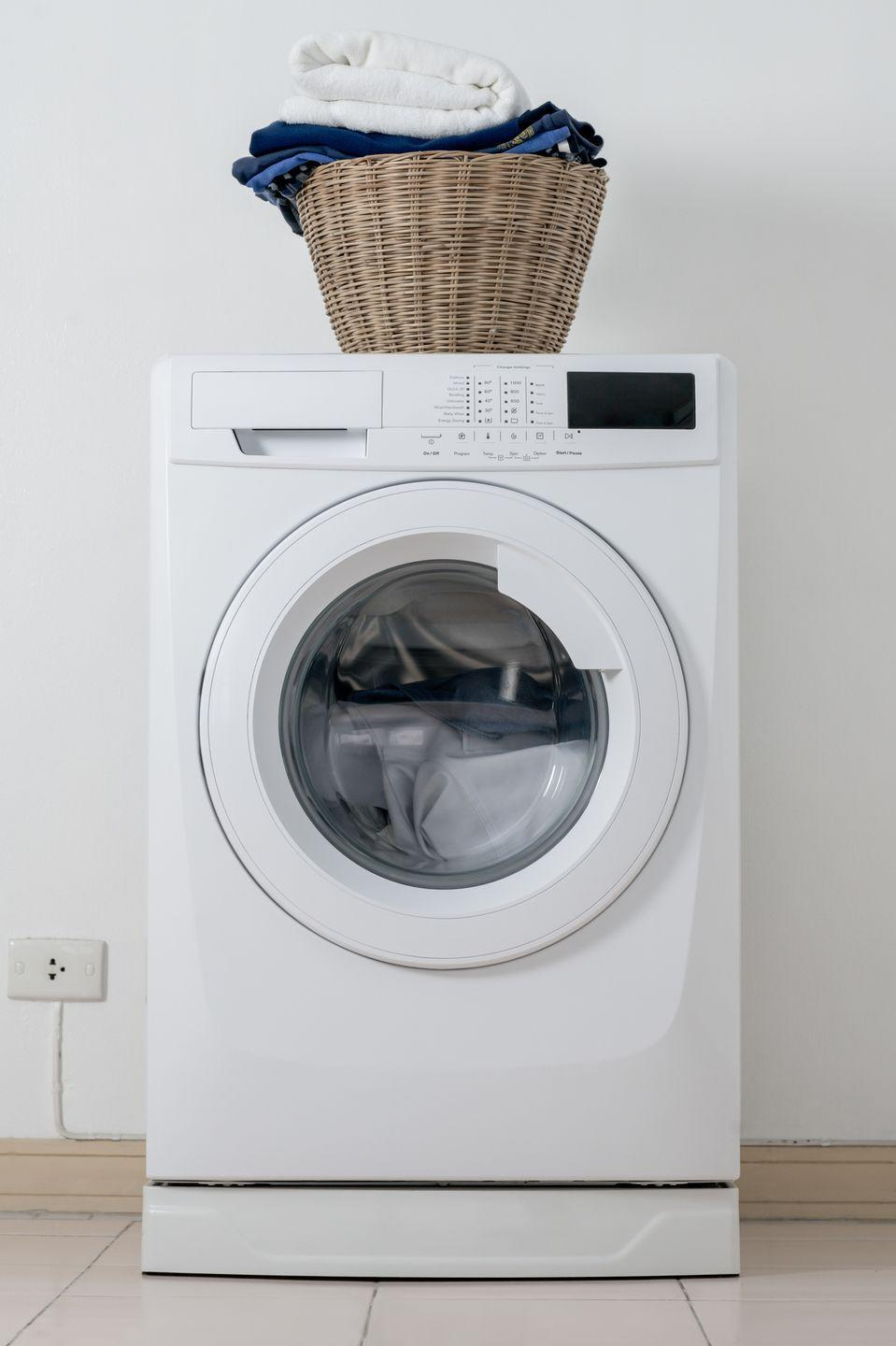 "<p>To clean out the dirt, mold, and other grimy residue that can build up in your washer, <em>Better Homes & Gardens </em>recommends that you <a href=""https://www.bhg.com/homekeeping/laundry-linens/tips-checklists/how-to-clean-washing-machine/"" rel=""nofollow noopener"" target=""_blank"" data-ylk=""slk:run a hot cycle with vinegar"" class=""link rapid-noclick-resp"">run a hot cycle with vinegar</a>. First, run an empty, regular cycle on hot, using two cups of white vinegar instead of detergent. Then, mix about a quarter cup of vinegar with a quart of warm water and use this mixture — plus a sponge and dedicated toothbrush — to clean the inside of the machine.</p><p>Finally, run one more empty, regular cycle on hot, without detergent or vinegar. If you'd like, you can add half a cup of baking soda to the drum to help clear away buildup loosened from the first cycle. </p>"