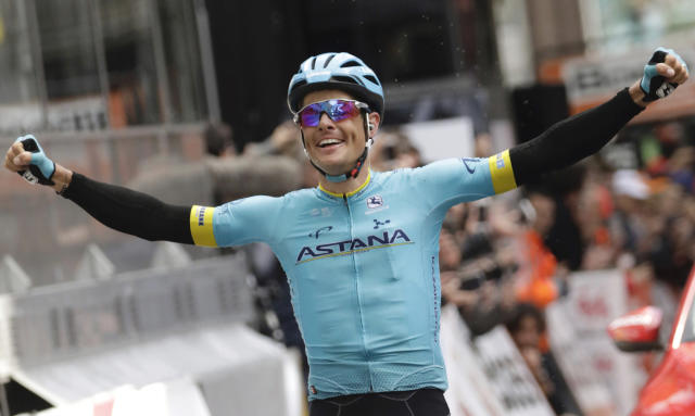 FILE - In this file photo dated Sunday, April 28, 2019, Denmark's Jakob Fuglsang from the Astana Pro team crosses the finish line to take first place in the Liege Bastogne Liege cycling race in Ans, Belgium. Danish rider Jakob Fuglsang won the Criterium du Dauphine stage race for the second time after keeping his overnight lead in Sundays final stage. (AP Photo/Olivier Matthys, FILE)