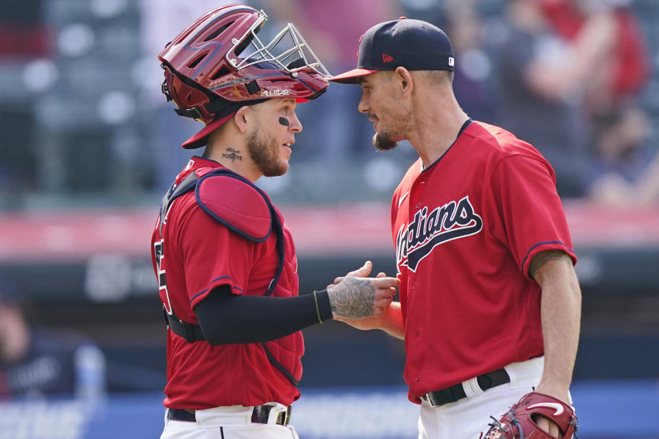 Cleveland Indians relief pitcher Nick Wittgren, right, is congratulated by catcher Roberto Perez after the Indians defeated the Kansas City Royals 4-2 in a baseball game, Wednesday, April 7, 2021, in Cleveland. (AP Photo/Tony Dejak)