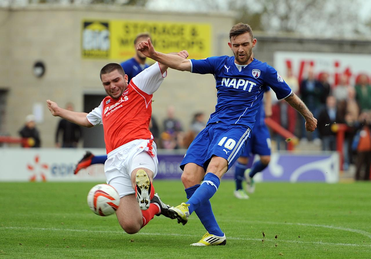 Morecambe's Alex Kenyon (Left) tackles Chesterfield's Jay O'Shea during the Sky Bet League Two match at Globe Arena, Morecambe.
