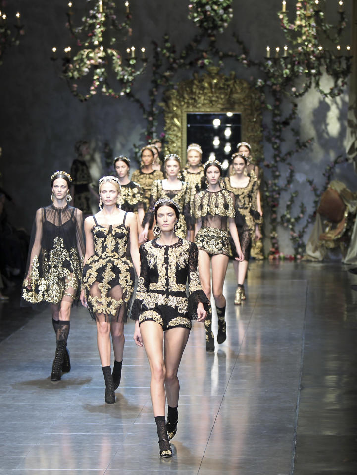 Models wear creations part of the Dolce & Gabbana women's Fall-Winter 2012-13 fashion collection, during the fashion week in Milan, Italy, Sunday, Feb. 26, 2012. (AP Photo/Antonio Calanni)