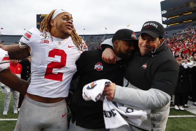 Ohio State defensive end Chase Young (2), linebackers coach Al Washington and head coach Ryan Day celebrate after a 56-27 win against Michigan after an NCAA college football game in Ann Arbor, Mich., Saturday, Nov. 30, 2019. (AP Photo/Paul Sancya)