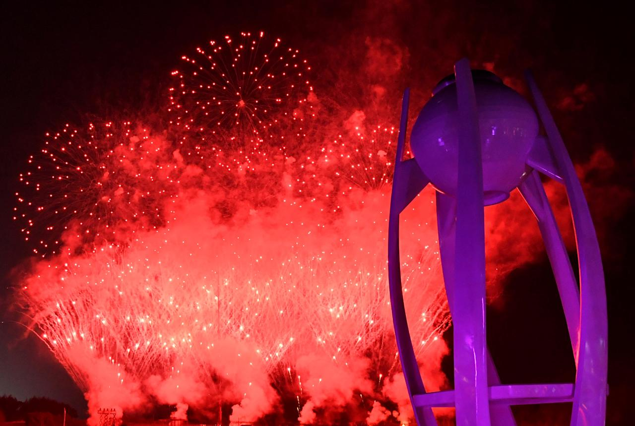 """Pyeongchang 2018 Winter Olympics - Closing ceremony - Pyeongchang Olympic Stadium - Pyeongchang, South Korea - February 25, 2018 - General view of the torch after it is extinguished and fireworks during the closing ceremony. REUTERS/Florian Choblet/Pool SEARCH """"OLYMPICS BEST"""" FOR ALL PICTURES. TPX IMAGES OF THE DAY."""