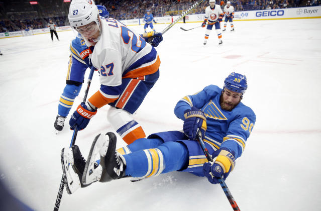 St. Louis Blues' Ryan O'Reilly (90) falls alongside New York Islanders' Anders Lee (27) during the second period of an NHL hockey game Saturday, Jan. 5, 2019, in St. Louis. (AP Photo/Jeff Roberson)