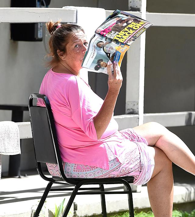 "<p>At the halfway house where Miller is living until May 25 — when she's really free — she's being provided with ""a structured and supervised environment where she'll be given employment counseling, job placement, and financial management assistance."" Apparently, she's also provided with tabloids, because she was snapped reading an issue of <em>Star</em> about Brad Pitt and Jennifer Aniston possibly reconciling. (Photo: All Access / SAF / Splash News) </p>"