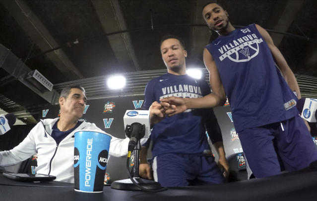 Villanova head coach Jay Wright, left, bumps his fist with Mikal Bridges as Jalen Brunson, center, and Bridges arrive at a news conference. (AP)