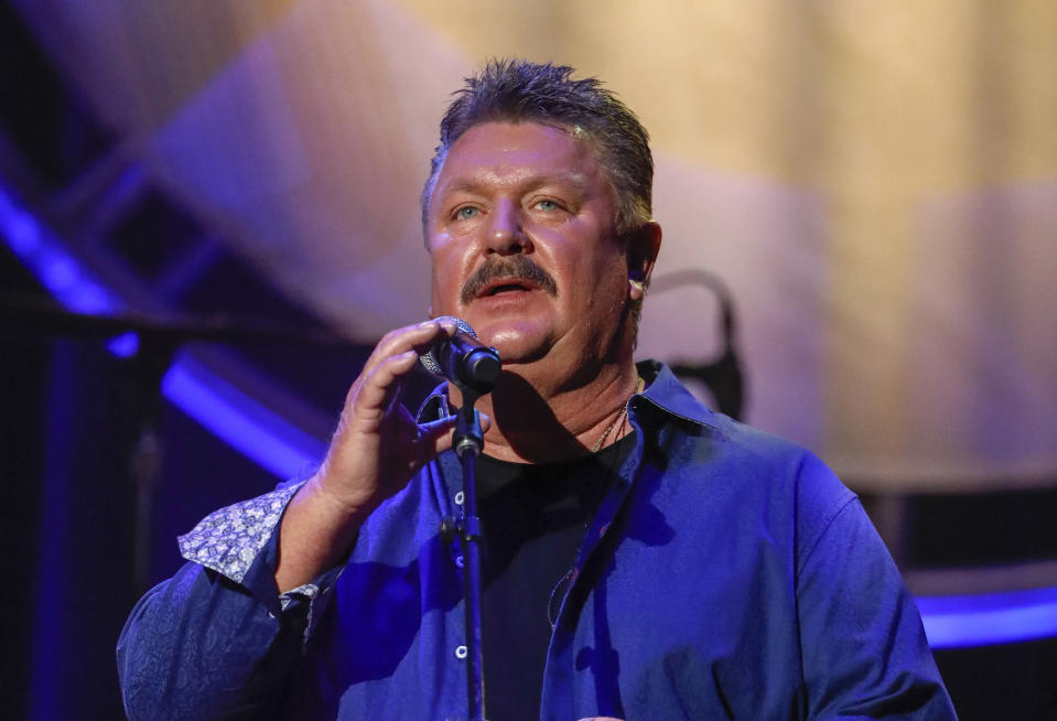 FILE - This Aug. 22, 2018 file photo shows Joe Diffie performing at the 12th annual ACM Honors in Nashville, Tenn. A publicist for Diffie says the country singer has tested positive for COVID-19. Diffie is under the care of medical professionals and is receiving treatment. (Photo by Al Wagner/Invision/AP, File)