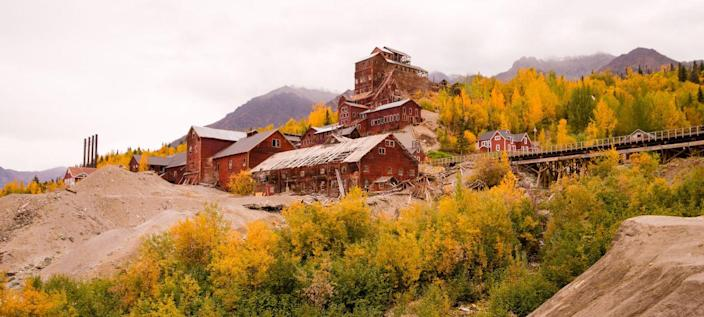 <p>Shrouded in fog and beguiling fall foliage in the Alaskan wilderness, the Kennicott Mines and surrounding town are (almost) as creepy as Packard Sawmill in <em>Twin Peaks</em>. The town of Kennecott was once flourishing with copper miners and their families until resources were depleted by the late 1930s and all of the townspeople fled—except for a family of three. It was totally abandoned by the 1950s when the family watching over it finally left.</p>