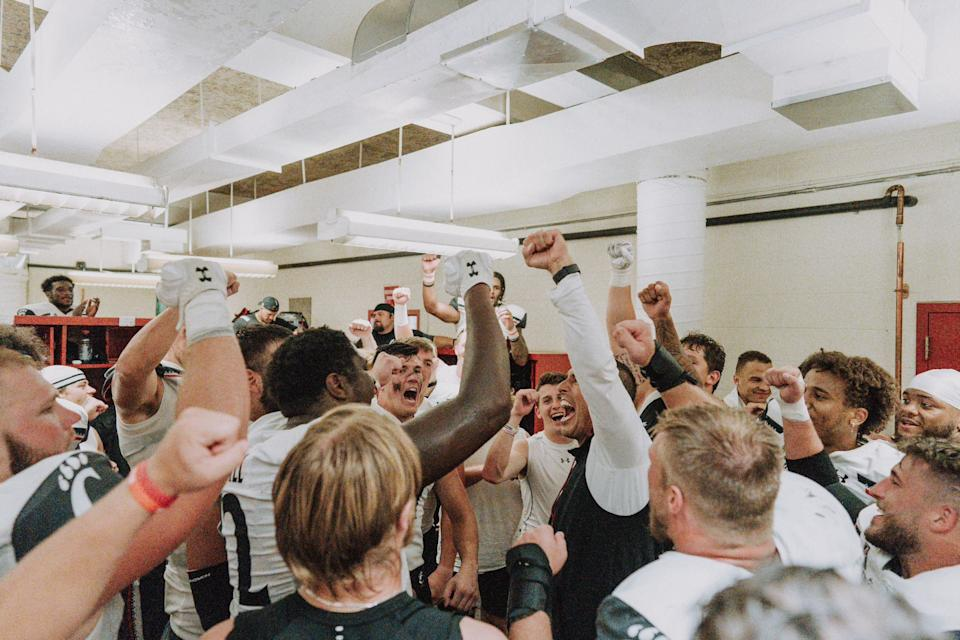 Cincinnati head coach Luke Fickell leads a round of celebration after the Bearcats rallied to beat the Hoosiers. (Special to Yahoo Sports)
