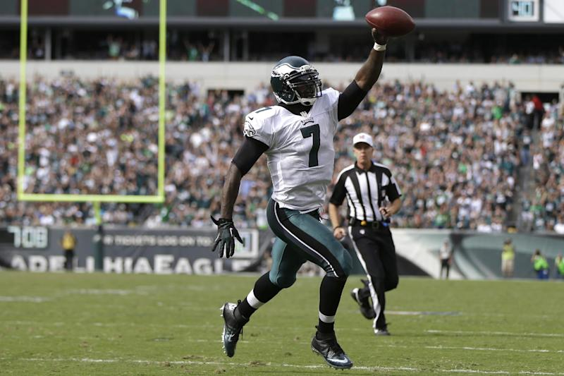 Philadelphia Eagles' Michael Vick runs for a touchdown during the second half of an NFL football game against the San Diego Chargers, Sunday, Sept. 15, 2013, in Philadelphia. (AP Photo/Matt Rourke)