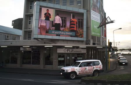 Election voting public service message is seen on a large video screen located on the main street of the Fiji capital of Suva