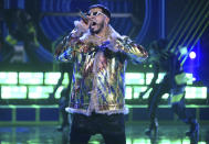 FILE - Anuel AA performs at the Latin American Music Awards in Los Angeles on Oct. 17, 2019. The Puerto Rican rapper-singer is nominated for seven Latin Grammy Awards including one for best new artist. (Photo by Chris Pizzello/Invision/AP, File)