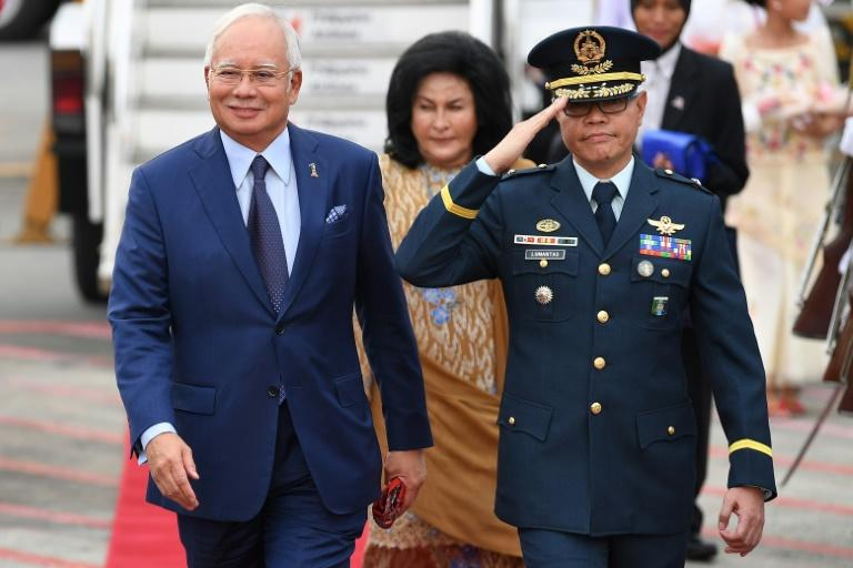 Malaysian Prime Minister Najib Razak (L) has long been accused of repressing dissent