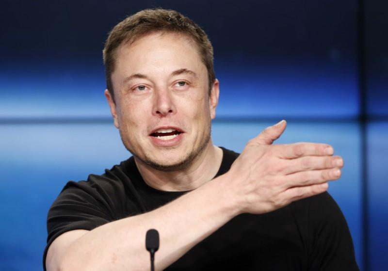 Musk speaks at a press conference following the first launch of a SpaceX Falcon Heavy rocket in Cape Canaveral