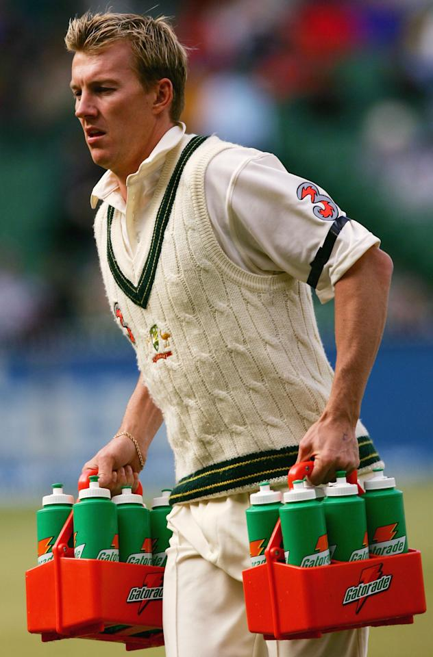 MELBOURNE, AUSTRALIA - DECEMBER 28:  Brett Lee of Australia carrying the drinks during day three of the Second Test between Australia and Pakistan played at the MCG on December 28, 2004 in Melbourne, Australia.  (Photo by Hamish Blair/Getty Images)